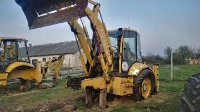 Piese dezmembrari buldoexcavator Komatsu WB 93